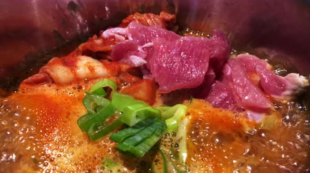 ramen : Hot boiling Kimchi Chigae soup with beef top view - Korean home cook cuisine