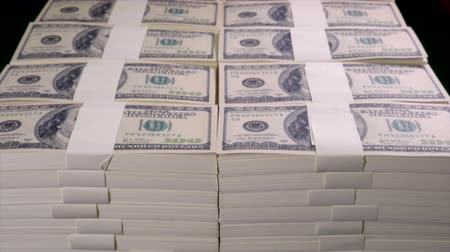 giveaway : Stacks of US dollars in hundred dollar banknotes. Stock Footage
