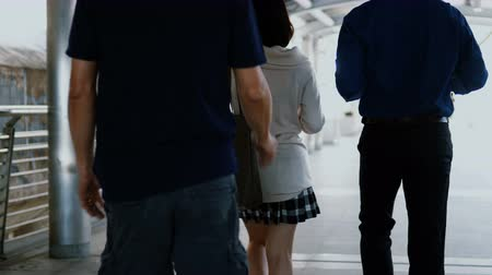 Tracking camera with pretty woman was pickpocket in behind while walking with her boyfriend in a public place