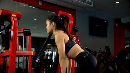 Close up and fix shot with pretty woman workout with lifting up dumbbell at gym, fitness healthy concept Vídeos