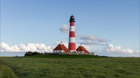 schleswig : Colorful lighthouse at Westerhever, Germany Stock Footage