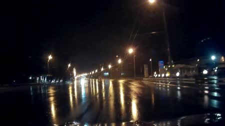 low lighting : This is mysterious strange bad weather driving video of a Night Foggy Rainy Dangerous Road. Lights, pools, puddle, rain and fog. Really nice colours and pleasure feelings guaranteed!: You can use this mist video in cinematic credits, movie background, in