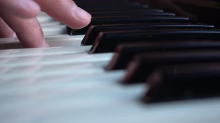Playing Keybords Music Background is a beautiful natural  close up video of a white and black piano keys with a playing fingers. Стоковые видеозаписи