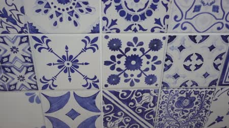 Patchwork Tile Background features an interesting old style wall  video in a blue white colors