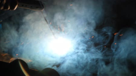 Arc welding metal and sparks