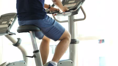cardio : Athletes doing spinning exercise in sport gym Stock Footage
