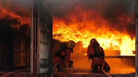 Firefighters fighting a fire, Firefighter training with gas and flame