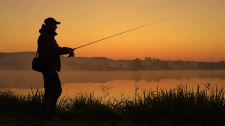 fly fishing : Silhouette of Fisherman