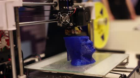 biust : 3D printer while working. Modern robotic technologies. Artificial intelligence. Cybernetic systems today. HD