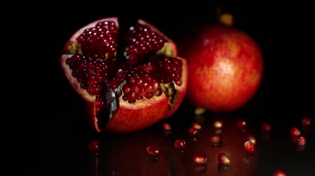 antioxidant : Two fruit grenades lie on a black table on a black background