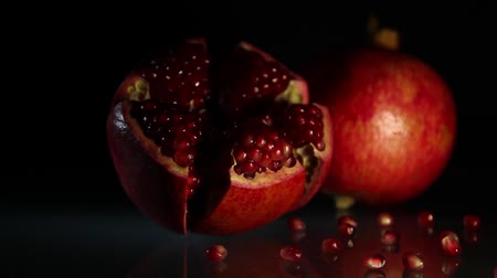 antioxidant : Two bright big grenades on a black background. HD. Close-up