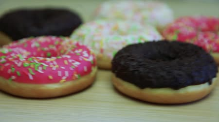engorda : Donuts in the glaze lie on the table. Fast Video Rotation. HD