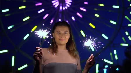 bochechudo : A beautiful girl is happy with a holiday with fireworks in her hands. slow motion.