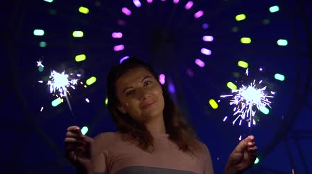 mischief : An attractive girl is happy with a holiday with fireworks in her hands. slow motion. HD