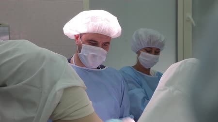 traumatic : The surgical group of the hospital performs a gynecological operation using surgical instruments.4K Stock Footage