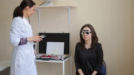 sighted : Woman doctor examines a womans vision to a patient using new medical technologies.4K Stock Footage