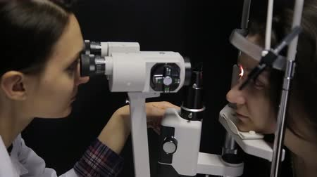 phoropter : Close-up. The doctor performs a patients vision study using the newest technology.4K