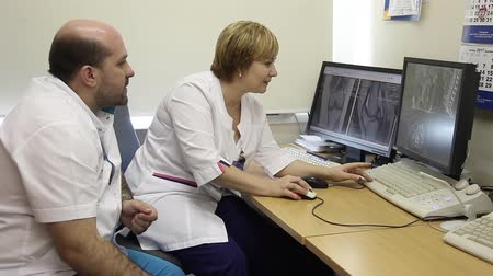tomography : Two doctors discuss the results of computed tomography