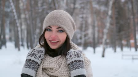портфель : portrait of a young girl walking in the winter forest who is looking at the camera and smiling