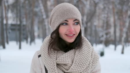 портфель : charming young woman with blue eyes walks through the winter forest looks around and smiles. close-up
