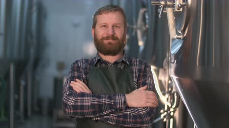 portrait of successful brewer businessman with beard at beer factory