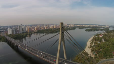 kijev : The Moscow Bridge  is a structure in Kiev, Ukraine, built in 1976. It is a cable-stayed bridge with the beam of the main span being held by a cluster of steel ropes which are fixed to a 119 m tall A-pylon.