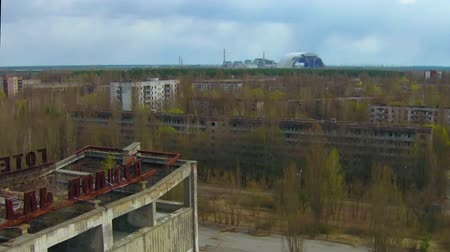 nuclear accident : Pripyat ghost town near Chernobyl Aerial New sarcophagus for the destroyed reactor at Chernobyl Stock Footage