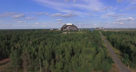 nuclear accident : Chernobyls arch. Aerial, 4K. The New Safe Confinement NSC or New Shelter is a structure intended to contain the nuclear reactor at Chernobyl, Ukraine, part of which was destroyed by the Chernobyl disaster in 1986