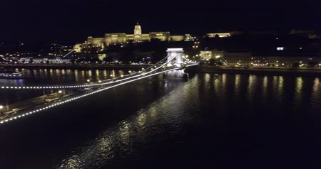 budapeste : Aerial night view on beautiful bridges of Budapest. This session is full of different aerial shots of Danube river in the night in Budapest, Hungary. Youll see the famous bridges of the city in night lights and many cruise ships