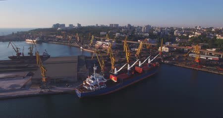 deep seaport : City port on sunrise. Urban aerial view. Odessa Marine Trade Port is one of the largest ports in the Black Sea basin, with a total annual traffic capacity of 40 million tonnes.