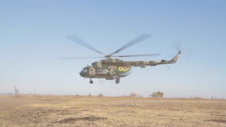 společenská místnost : Military helicopter takes off. The Mil Mi-8 is a Soviet-designed medium twin-turbine transport helicopter.