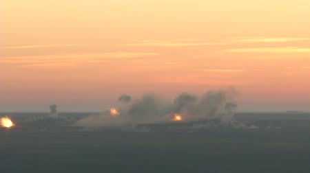bombardment : Battlefield in fire: the bombardment of heavy artillery.Bombardment early in the morning. Many shells and thick smoke Stock Footage