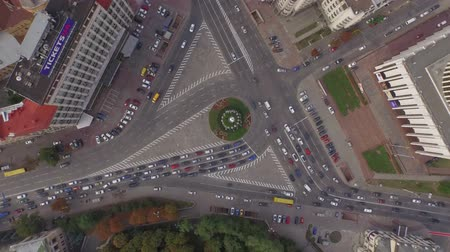 kilometer : Traffic at the big city. Morning rush hour. Aerial filming. This footage was made on the oldest district of Kyiv city