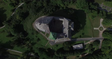 антиквариат : Medieval Olesko castle near Lviv city. It stands on a picturesque hill. Aerial. The Olesko Castle amazes by its fantastic beauty. This is a unique monument of architecture and history of 13-18 centuries.