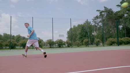 trik : Between the legs trick tennis shot. Slow Motion