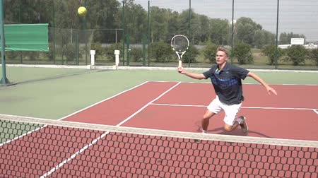 tennis game : Net play in tennis. Slow motion video. Part 2. The player shows his tennis skills. This session is full of many different extremely good shots