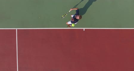 tennis game : Serve with professional tennis player. Top view from the quadrocopter. 4K