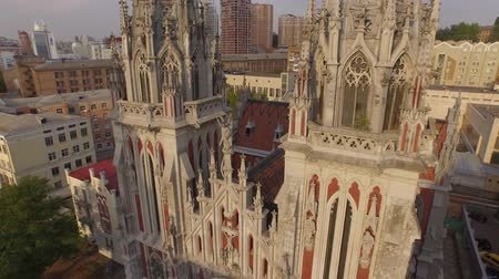 most : St. Nicholas Roman Catholic Cathedral in gothic style. Aerial filming. Aerial session near and around religious building in Kyiv Dostupné videozáznamy