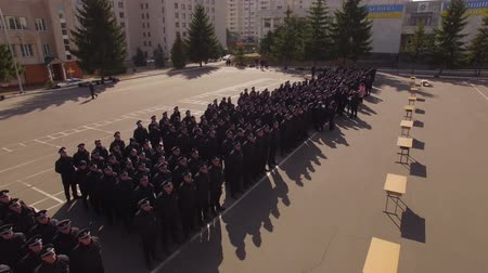 policja : Police Academy. Recruits Standing on the parade ground. Aerial. Police Academy. Aerial filming