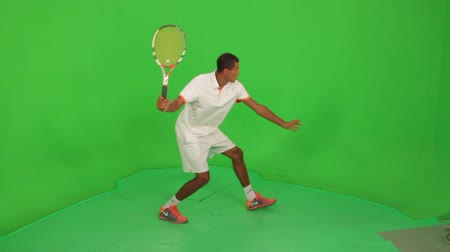 tennis player : Professional tennis player makes different types of shots on a green screen. Session with professional tennis player Stock Footage