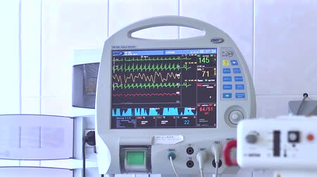 vital signs : Hospital Icu Monitor at reanimation department of heart surgery clinic. monitor displays patient vital signs Stock Footage