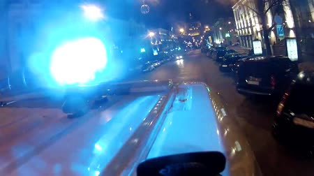 uyarmak : Blue ambulance flashers. Close-up on the car. Car moving on the road Stok Video