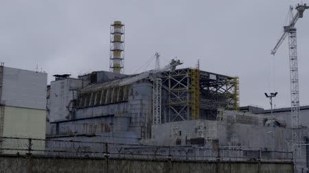 sarcophagus : Construction on the destroyed reactor of the Chernobyl nuclear power plant. 30 years after Chernobyl accident