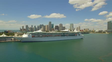 hydroplane : Aerial, 4K. Cruise Ship at port of Miami and skyscrapers behind it. Florida, USA Port passenger terminal and cruise liner in harbor Stock Footage