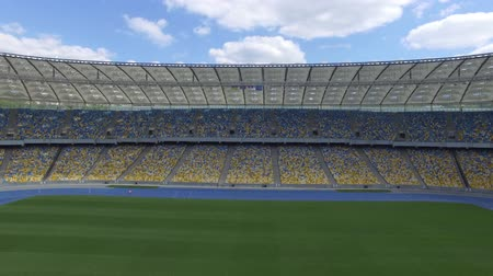 общественный : Flying inside huge modern empty stadium. Movement along the fan sectors. Kyiv Olympic stadium, Ukraine