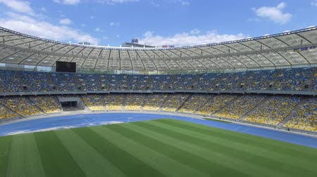 forma : Flying inside huge modern empty stadium. Kyiv Olympic stadium, Ukraine