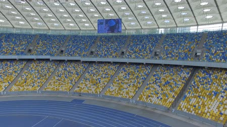 общественный : Flying inside huge modern empty stadium. Kyiv Olympic stadium, Ukraine