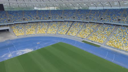 forma : Flying inside huge modern empty stadium. Aerial panorama. Kyiv Olympic stadium, Ukraine