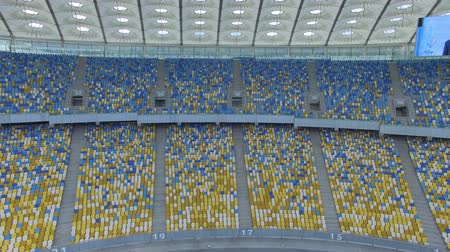 общественный : Flying above grass on a small height inside huge modern empty stadium .Kyiv Olympic stadium, Ukraine Стоковые видеозаписи