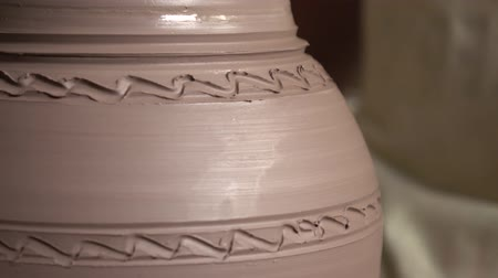 ceramika : The artist works with clay at art studio and creates a pitcher. Creating a pitcher from clay